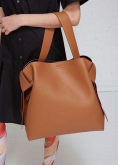 Apr 2020 - Buy the Acne Studios Musubi Maxi at Totokaelo Fashion Handbags, Purses And Handbags, Fashion Bags, Leather Handbags, Luxury Handbags, Cheap Handbags, Fashion Accessories, Ladies Handbags, Travel Handbags