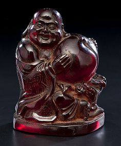 Chinese Mi Le Fo Buddha composed of root amber.