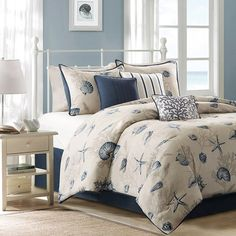 Refresh your master suite or guest room with this charming cotton coverlet set, showcasing a whimsical coastal motif.    Product: