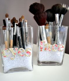 Make up brush storage.  Two jars (I chose a square shape), letter cut outs (That were on Clearance!), a hot glue gun, & colerfill (tiny clear beads) to hold the brushes upright in the jars.