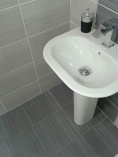 Willow Dark Grey Floor tile by BCT 33x33cm £12.51 metre square. A matt ceramic floor tile with a line pattern by British Ceramic Tiles . Code BCT11644. Great as a bathroom or kitchen floor tile. The Willow Dark Grey floor tile also comes in Light Grey and Neutral cream colours and has matching White, Light Grey, Dark Grey and Neutral cream wall tiles. We sell the best tiles at cheap prices on-line in the UK with fast nationwide delivery at Ceramic Planet.
