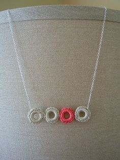 "Crochet Ring Necklace Tutorial...the tutorial calls for ""jump rings"" but I think even some washers would work."