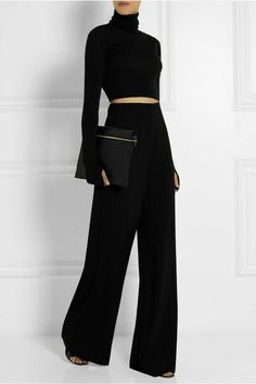 Black wide leg trousers and black cropped top.
