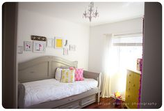 love the wall art, lighting, and colors. perfect for a chic girl's room