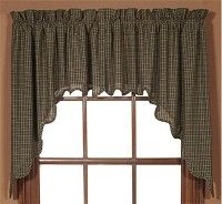 These Kettle Grove Swag Curtains are very charming and will add to your primitive theme.  These curtains are lined and are black and tan plaid.  We have matching tiers, valances, panels, bedding,  and quilted kitchen accessories all sold separately.  http://www.primitivestarquiltshop.com/Kettle-Grove-Swag-Curtains_p_75.html  $23.95