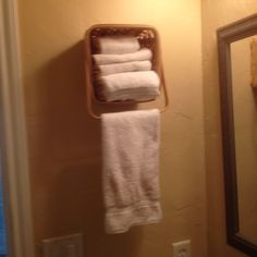 Woven basket w/moving handle: $1 from Dollar Store  Anchors, screws & washers: $2.35 from ACE Hardware  A towel bar & wash cloth storage for space-challenged bath: PRICELESS