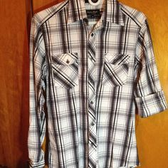 Plaid button down top Light weight black, gray and white plaid button down shirt. Super cute layered with a shirt under neath and a cardigan on the outside with skinny jeans and boots. Eighty-eight Platinum Tops Button Down Shirts