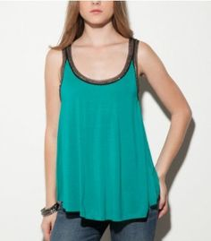 $29.50, Light as a feather and ultrasoft, this barely-there top is a must for style-setters. The sexy silhouette is polished with edgy chains and a mesh trim, bringing a rocker feel to your day-to-night looks. ? Jersey top. Scoop neck. Sleeveless. Relaxed fit. ? Chain with mesh trim neckline and sleeve hems ? 100% Rayon ? Hand wash Women's > Shirts & Tops > Tanks & Camis