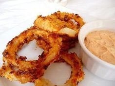 "Oven-fried Onion Rings: 1 Med-lg Sweet Onion Sliced ½"" Thick, ¼ C Flour, ½ T Salt, ¼ T Ground Black Pepper, ¼ T Cayenne Pepper, ½ C Buttermi..."