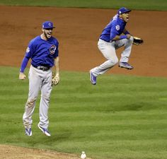 Final out. Jump. Kris Bryant & Addison Russell