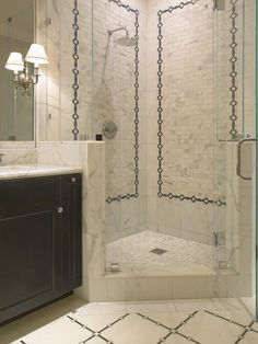 SDG Architects - bathrooms - rain, shower head, corner, seamless glass shower, marble, tiles, shower surround, tumbled marble, inset tiles, black, bathroom vanity, marble, countertop,