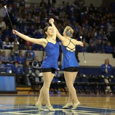 Three things I love about this action shot... 1-wonderful smile, 2-on toes, and 3 - twirling for both sides of the crowd at one time!