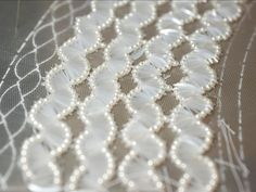 Hand-embellished beaded embroidery for a haute couture dress; fashion atelier; dressmaking // Lesage for Chanel