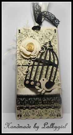 I have made this tag using the first edition chic noir papers from trimcraft,an SU bird punch,a tonic punch for the rose, a memory box swirls die,sizzix birdcage die,lace from my stash and ribbons,spotty buttons,pearls are all from meiflower crafts