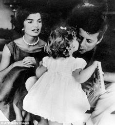 Caroline gives her father a kiss as mother Jacqueline looks on in this 1959 photo