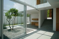 Interior , Glass Sliding Door Ideas Giving Awesome Design For Your House : Small Courtyard With Glass Sliding Door Design For Attractive Look