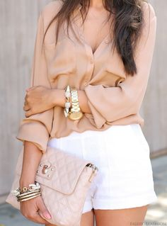 I love the light pink flowing shirt with the high wasted shorts and the bags #fashion #style