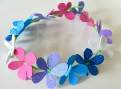 a Summery Flower Crown from Foam Sheets - A Kid's Craft Make a floral crown from foam sheets, pipe cleaners and ribbon. The DIY Mommy.Make a floral crown from foam sheets, pipe cleaners and ribbon. The DIY Mommy. Foam Sheet Crafts, Foam Crafts, Crafts To Make, Crafts For Kids, Arts And Crafts, Crafts With Foam Sheets, Craft Foam, Children Crafts, Kids Diy
