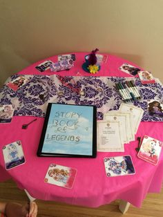 "Colleen's Ever After High Party - registration table where they signed the ""Book of Legends"" and received their class schedule and character necklaces."