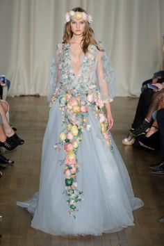 Not for the faint of heart, this statement Marchesa gown belongs in a dreamy outdoor wedding.