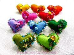 beaded felt hearts would look so sweet hanging from a jewelry tree as a table center