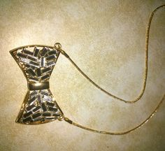 Bow necklace with crystal baguettes