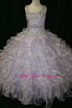Long Girls pageant dress by Little Rosie for Bali Bali Fashions LR916. Ruffle organza ball gown with beaded top. The fabric in this style is...