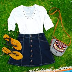 All about the details on this outfit. The American Rag white lace-up top and A-line denim skirt can easily transition to fall too.