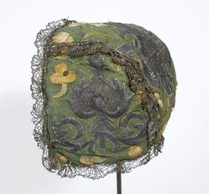 Early18th century child's cap, heavily embroidered. Additional detailed images. Note that individual stitches are easily seen. See Antique Textiles site.