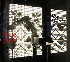 carlo ratti's free pixel for artemide, controlled using robotic arm