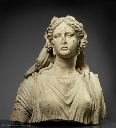 Female bust: Ariadne. 3rd century BC. Provenance: Falerii Novi. The young woman, who may be Ariadne, is veiled and crowned with vine branches and leaves and probably belonged to a cult group depicting the wedding of Dionysos.