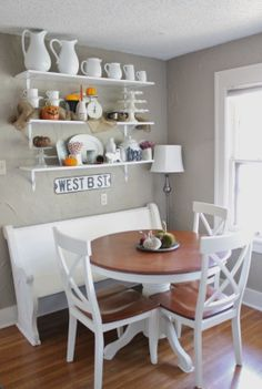 church pew in breakfast nook....love it.  Carrie,shelves would be cute in your kitchen:)
