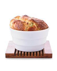 Ham, Leek and Gouda Soufflés | Soufflés are quite simple, says F&W's Grace Parisi: The base can be refrigerated overnight and the cooked soufflés reheated in the oven.
