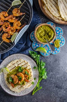 """Grilled Spiced Prawns on Homemade Lime Flatbread with Chimichurri Sauce   Chew Town Food Blog.  """"Concrete"""" background created by ericksonwoodworks.com."""