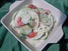 Creamy cucumber salad ~ Sliced cucumbers (skin on) add salt & let sit in refrigerator covered for about an hour (keeps cucs crisp), then add sliced or diced tomato's & sliced or diced onions (any variety), then add a jar of cucumber ranch dressing & add pepper.   I like to use a tupperware bowl, so that I can shake the bowl after adding all the ingredients.