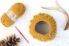 """Would you believe this free crochet bun beanie pattern (AKA ponytail hat) is worked in only single crochet and chain stitches? Despite it's simple construction, the """"cabled"""" look of this beanie is sure to dress up even the messiest of messy buns. Made with Lion Brand Lion's Pride Woolspun in """"Honey."""""""