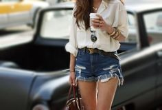 Her outfit. The cuffed high waisted denim shorts and a nice loose plain white collared shirt.