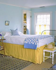 Color Plus Yellow  A butter-and-cream yellow bed skirt works best when warmed by an orange-yellow curtain stripe, and chilled, a bit, by breathy aqua walls.