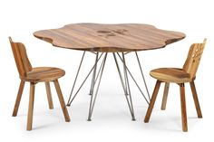 beautiful design of wooden table with flower shape and stylish wooden chairs