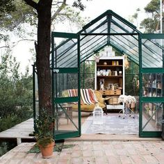 Nestled in the hills of Vallvidrera, on the outskirts of Barcelona, stands an idyllic greenhouse. Pictured on an uncharacteristically quiet day, this fragile space is usually crowded with photographers and stylists hoping to absorb its magical atmosphere. 'Gang and the Wool' is the studio of florist Manuela Sosa.  #fvonf #travel #nature #flowerstudio #gangandthewool