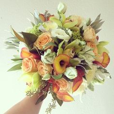 Fall bouquet. white parrot tulips, peach roses, rust calla lillies