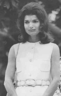 Unlike her composure during the late President's funeral, Jackie Onassis cried openly at his grave when she again visited there in 1972. (AP)