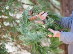 The holiday experts at HGTV.com share step-by-step instructions for using tree cuttings and homemade Christmas ornaments to dress up exterior windows.