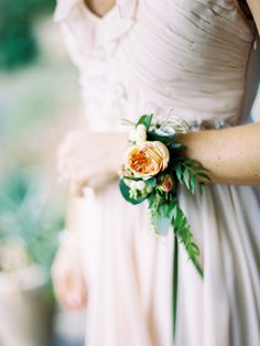 wrist corsage for bridesmaids. could do similar boutonnieres for yannick and ben. love everything except the color of that flower. should probably be lavender.