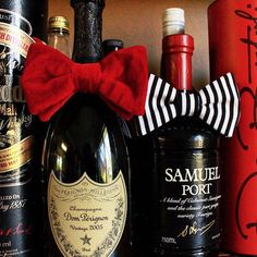 Yay, it's Friday! We're celebrating with champers, port, red velvet and black and white stripes! Playing with some of our traditional bow tie options on this fine Friday evening