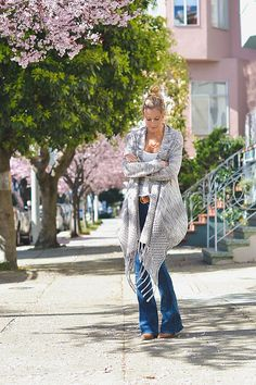 Street Style | Week of Oct. 13, 2014 | For a breezy, bohemian off-duty look, go for a luxe cardigan, and complete your denim with a thick belt that matches your tan booties.