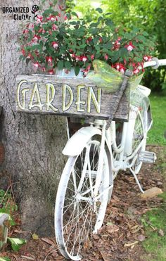 An old bike can become a beautiful planter by filling the front basket with blooms. Tour the rest of this creative garden.