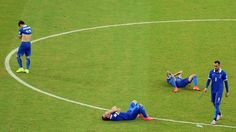 Giorgos Karagounis (L) of Greece reacts with his team mate Konstantinos Mitroglou (R) and others after being defeated