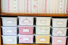 I love the decorative papers in the front of the bins, but if you look, you'll also see the great row of beautiful binders. -- from Kitchen Table Crafts