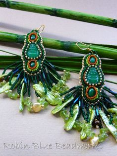 Zen Rainforest Bead Embroidered Earrings featuring vintage Buddha glass ands small malachite cabochons set in tiny size 14 Japanese seed beads. Embellished in the fringe are stick pearls, peridot chips and tiger eye